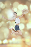 Joyful woman leaps with blur background Royalty Free Stock Photography