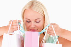 Joyful woman looking into her bags Royalty Free Stock Image