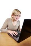 Joyful woman looking at laptop screen Stock Photo