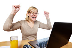 Joyful woman looking at laptop screen. Joyful woman looking at a laptop screen isolated Stock Image