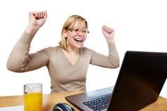 Joyful woman looking at laptop screen Stock Image