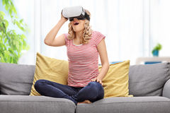 Joyful woman looking in VR goggles Royalty Free Stock Photos