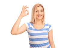 Joyful woman making OK sign with her hand Royalty Free Stock Photos
