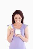 Joyful woman opening a box Royalty Free Stock Image