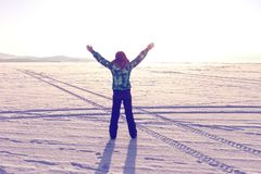 Joyful woman outdoors with her hands in the sky. Winter at Lake Baikal Royalty Free Stock Images