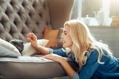 Joyful woman petting her cat Stock Photo