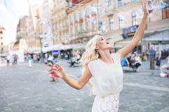 Joyful woman playing the bubbles Stock Images