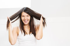 Joyful woman playing with her hair Royalty Free Stock Photography