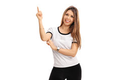 Joyful woman pointing up with her finger Stock Photography