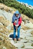 Joyful woman posing on the mountain footpath leading up the peak Royalty Free Stock Photo