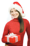 Joyful woman with a red Christmas gift Royalty Free Stock Photo