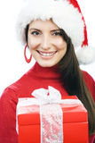 Joyful woman with a red Christmas gift Stock Photography
