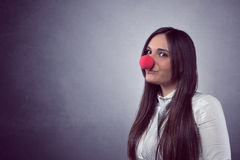 Joyful woman with red nose Stock Image
