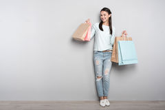 Joyful woman resting after shopping Royalty Free Stock Images