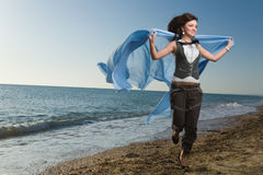 Joyful Woman Running At Sea Shore Stock Photos