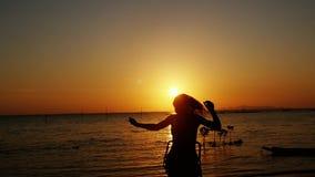 Joyful woman running enjoying nature on tropical beach at amazing sunset . slow motion. 1920x1080. Joyful woman running enjoying nature on tropical beach at stock video footage