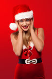 Joyful woman in a Santa Christmas outfit Stock Images