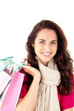 Joyful woman with a scarf holding shopping bags Stock Image