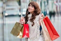 Joyful woman with shopping bags Stock Photo