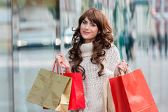 Joyful woman with shopping bags Stock Images