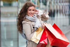 Joyful woman with shopping bags Royalty Free Stock Photos