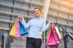 Joyful woman with shopping bags. Royalty Free Stock Photos