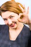 Joyful woman showing ok sign Royalty Free Stock Photos