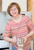 The joyful woman sifts a flour Stock Photos