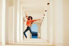 Joyful woman smile and jump Stock Photo