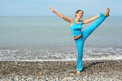 Joyful woman stretching on sea coast Royalty Free Stock Photo