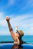 Joyful woman on summer car travel Stock Photography
