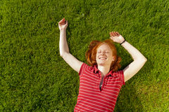 Joyful woman on summer grass Royalty Free Stock Photography