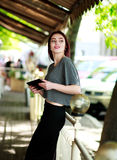 Joyful woman with tablet in summer cafe Royalty Free Stock Image