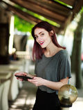 Joyful woman with tablet in summer cafe Stock Image