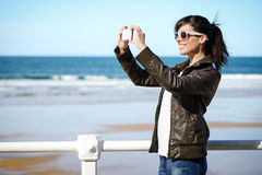 Woman on vacation taking photo Stock Image