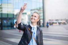 Joyful woman taking selfie in city center Royalty Free Stock Photo