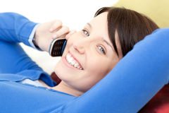 Joyful woman talking on phone Royalty Free Stock Images