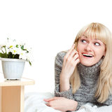 Joyful woman talking by phone Royalty Free Stock Photography