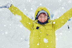 Joyful woman throwing snow. Royalty Free Stock Image