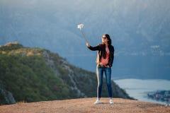 Joyful woman travel and photo selfie Royalty Free Stock Photos