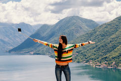 Joyful woman travel and photo selfie. In mountains. Picturesque location in Montenegro, Europe Stock Image