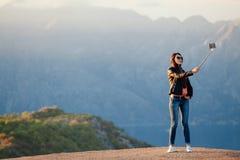 Joyful woman travel and photo selfie Royalty Free Stock Photo