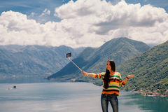 Joyful woman travel and photo selfie. In mountains. Picturesque location in Montenegro, Europe Royalty Free Stock Photo