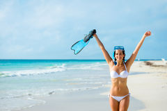 Joyful woman on tropical beach snorkelling royalty free stock images