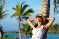 Joyful woman on tropical caribbean vacation Stock Photos