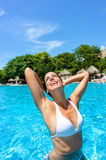Joyful woman in tropical resort swimming pool Royalty Free Stock Photo