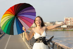 Joyful woman with umbrella Royalty Free Stock Images