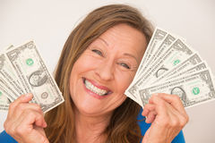 Joyful woman with us dollar Royalty Free Stock Photos