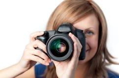 Joyful woman using a camera Stock Image