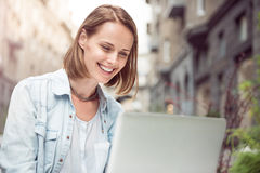 Joyful woman using laptop Royalty Free Stock Photography